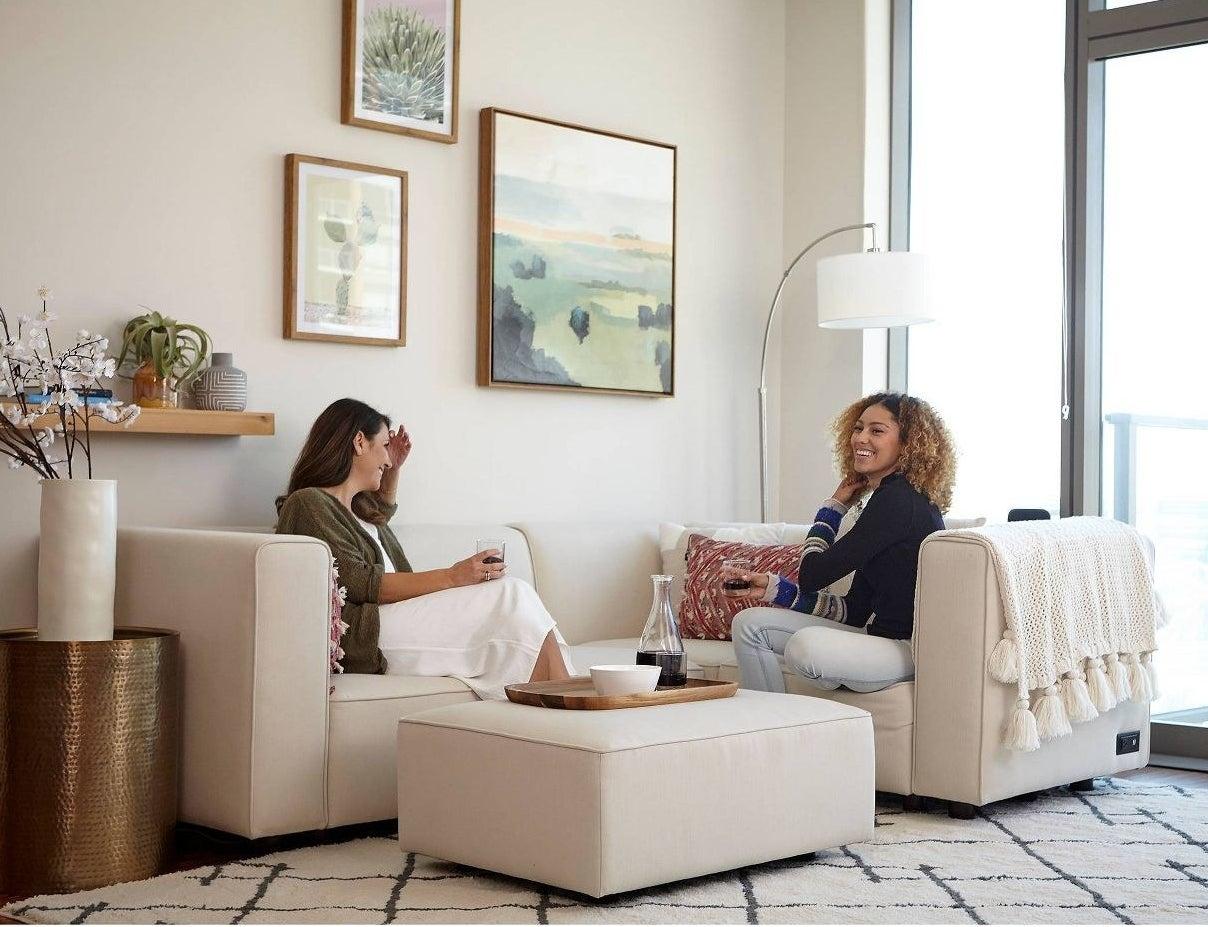 a cream modular sofa with an ottoman
