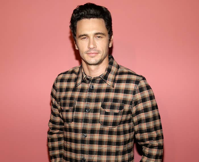 James casually dressed in a flannel-type checkered shirt