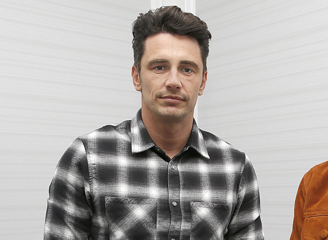 James in a black-and-white checkered shirt