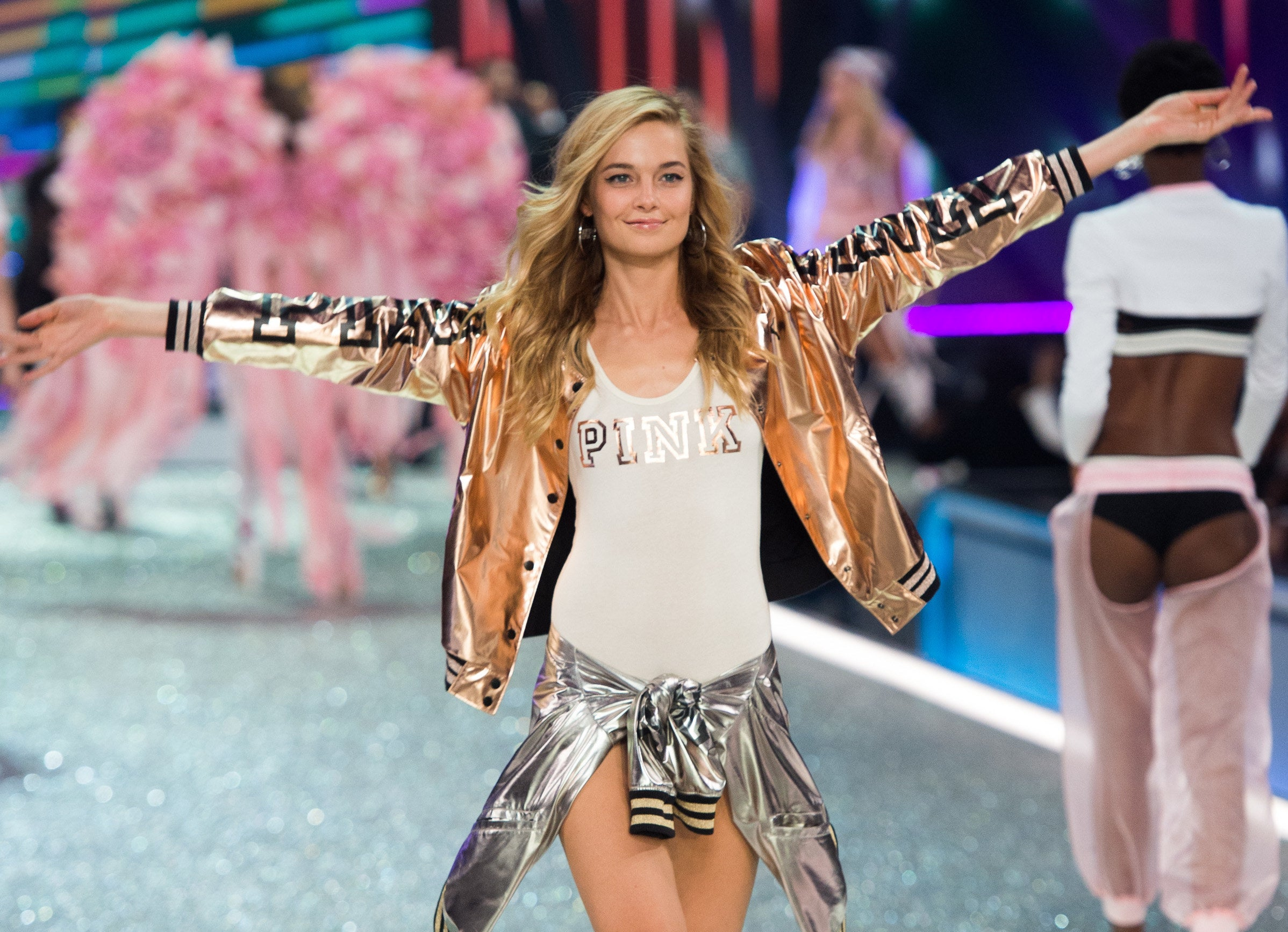 Bridget walks the Victoria's Secret runway with her arms stretched out