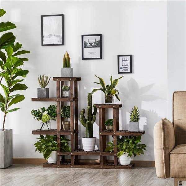 the plant stand stylized in a living room