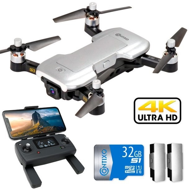 drone set showing everything included in the bundle: drone, remote control, memory card, battery