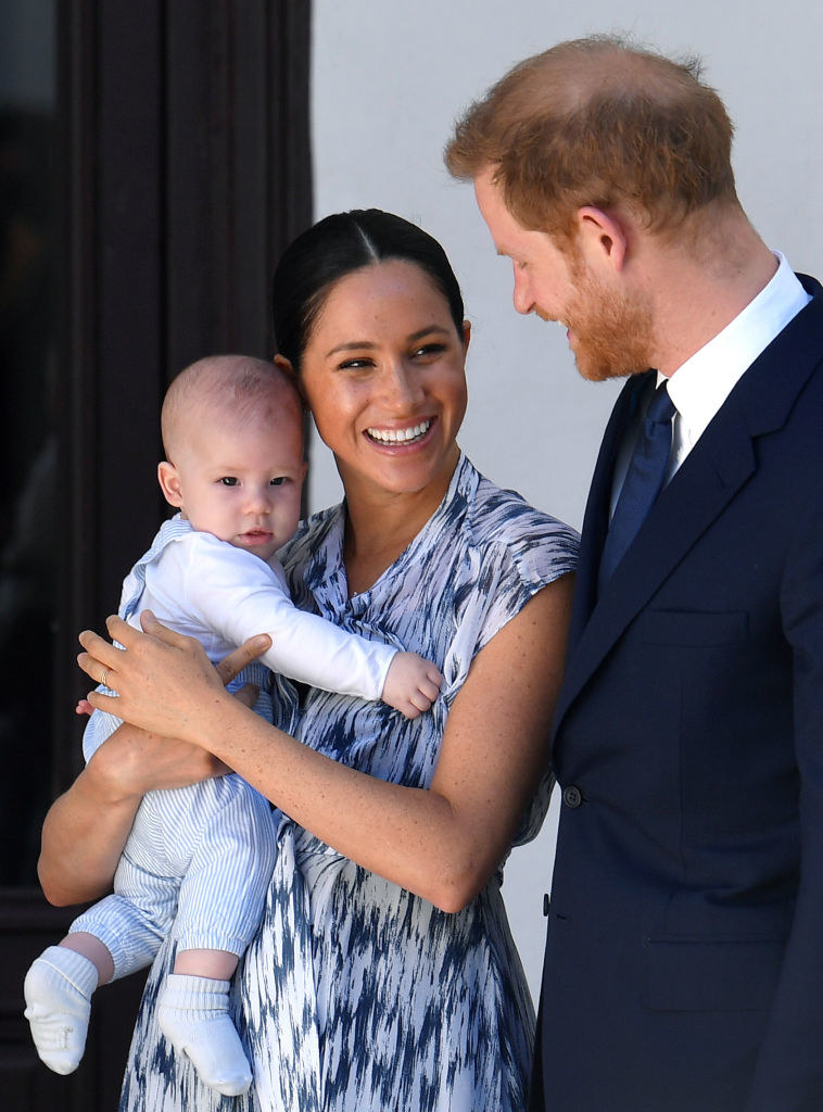 Prince Harry smiles at Meghan Markle as she holds their then-newborn son, Archie Harrison