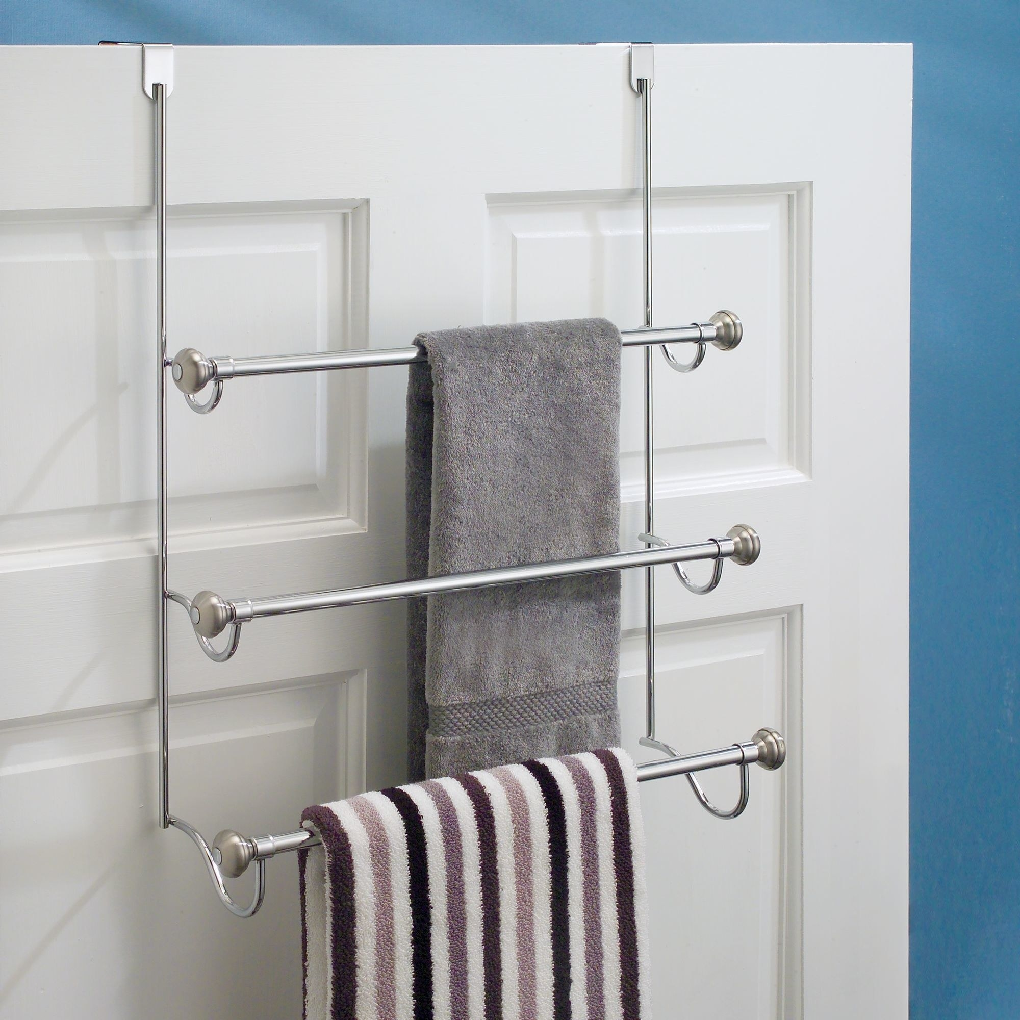 An over-the-shower door towel rack