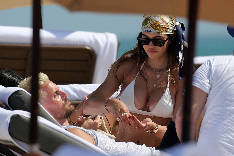 Amelia Hamlin and Scott Disick are seen on February 14, 2021 in Miami, Florida