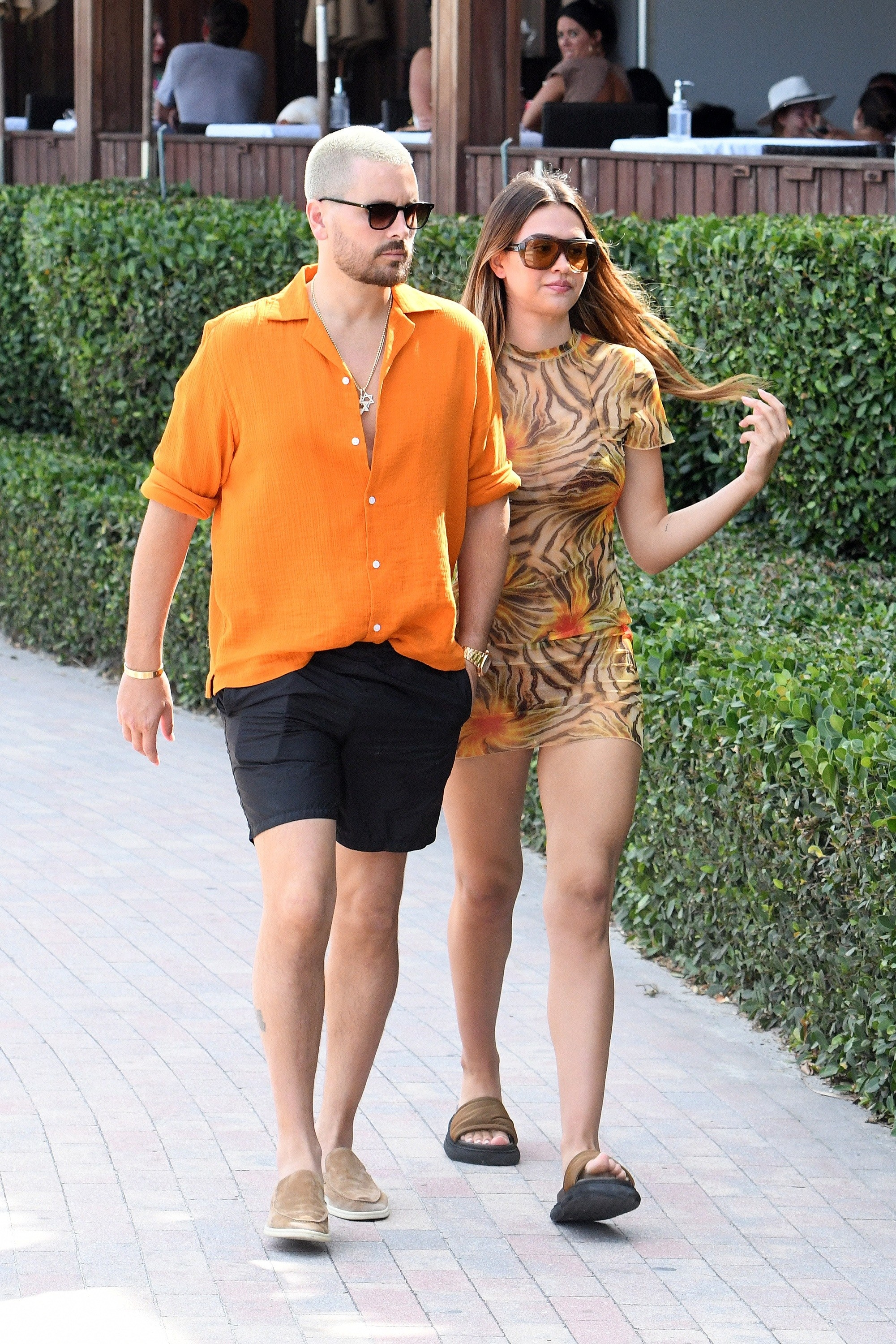 Scott Disick and Amelia Hamlin are seen walking at the beach on April 7, 2021 in Miami, Florida