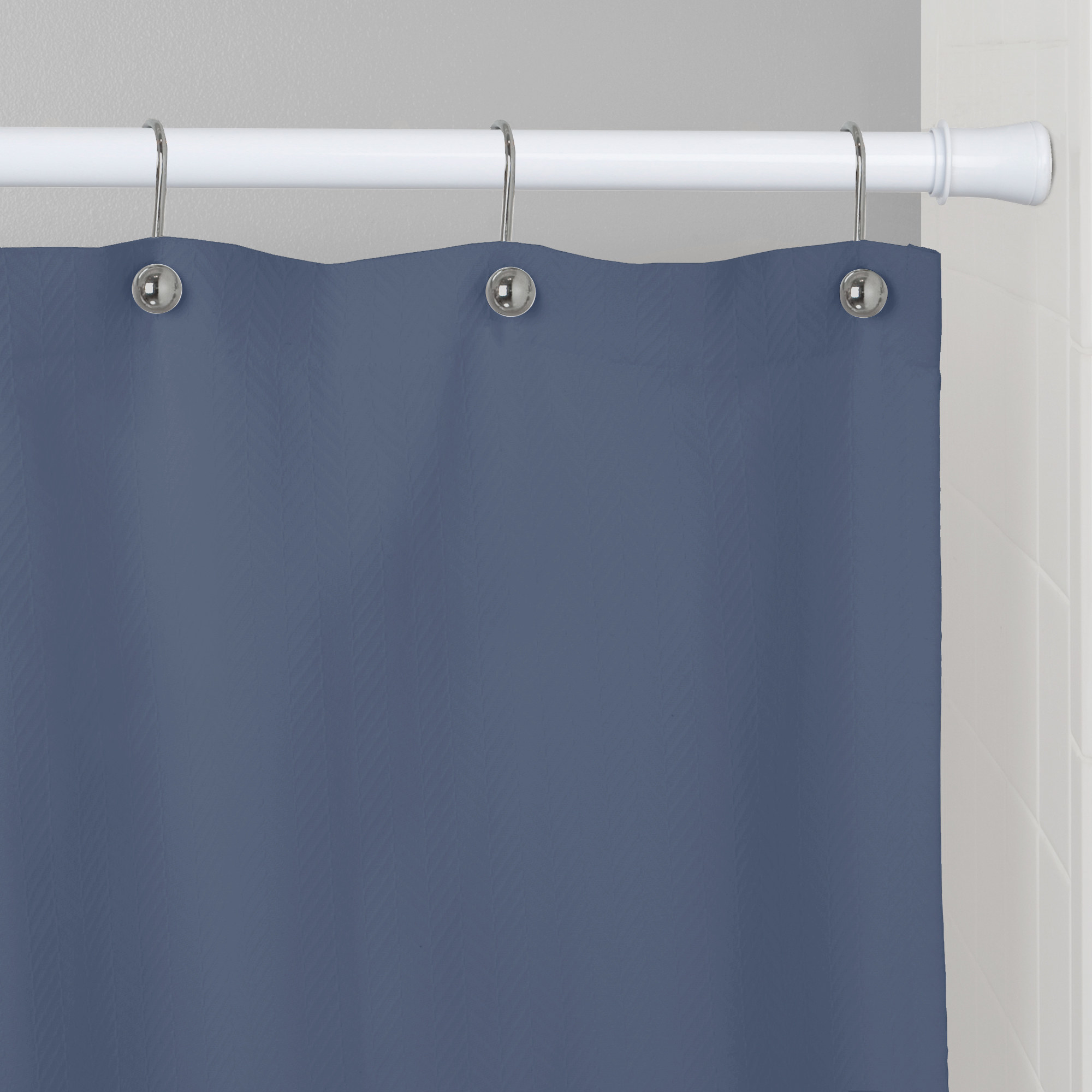 An easy-hang shower curtain tension rod