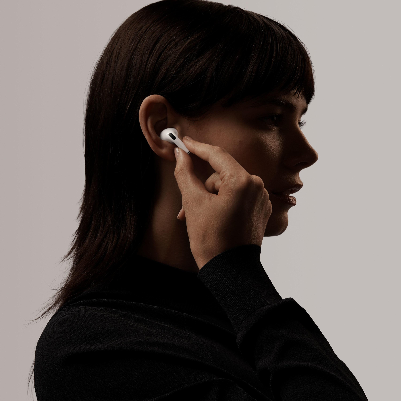 model putting an AirPod in their ear