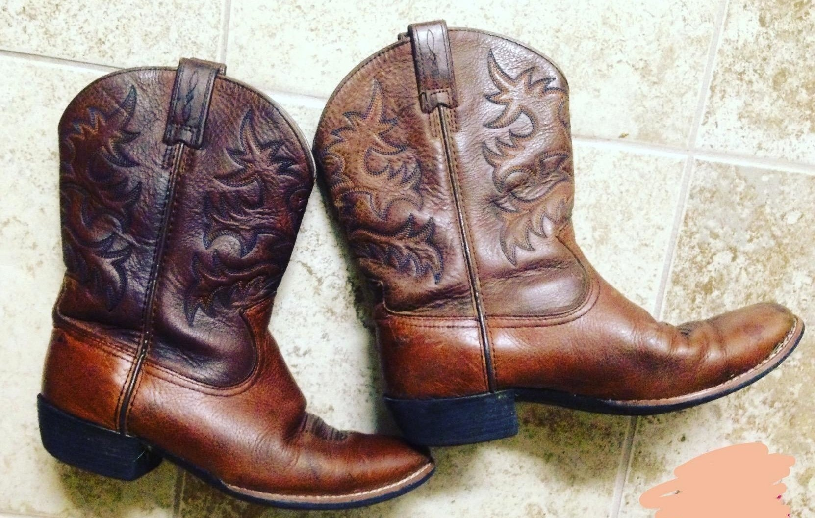 reviewer's boots restored to looking brand new after using a leather conditioner