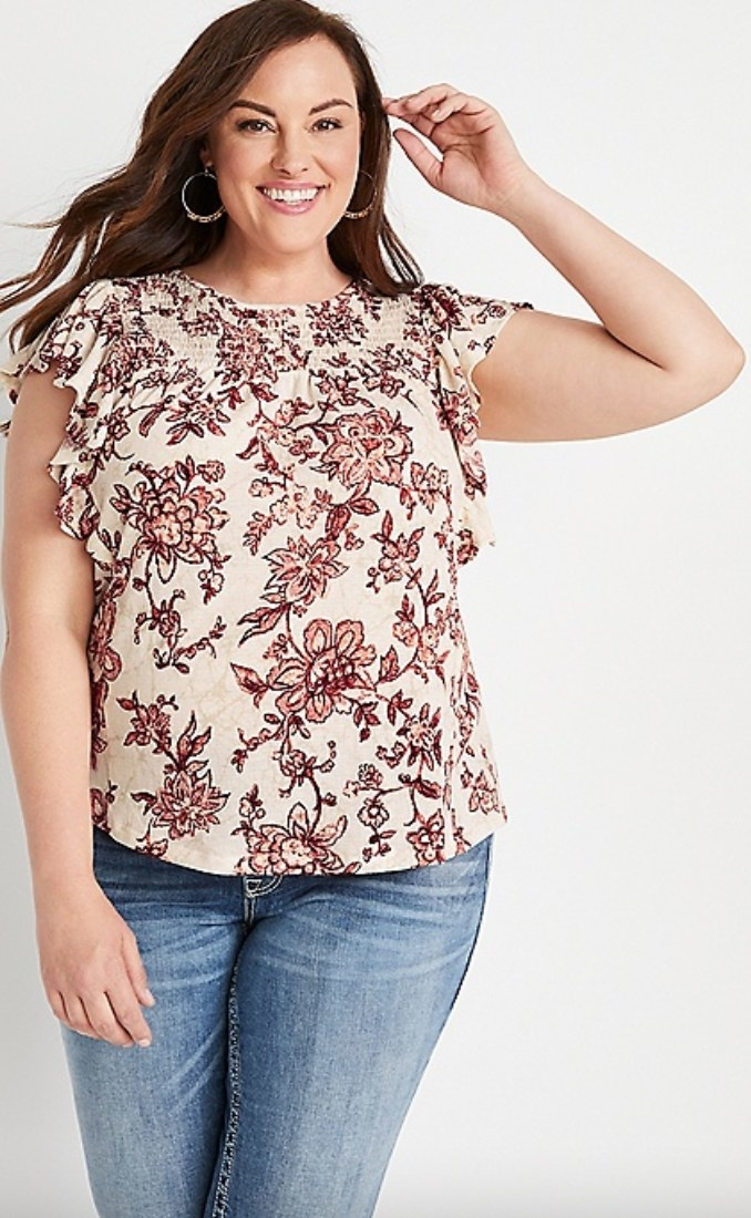 the plus-sized floral smocked blouse on a model