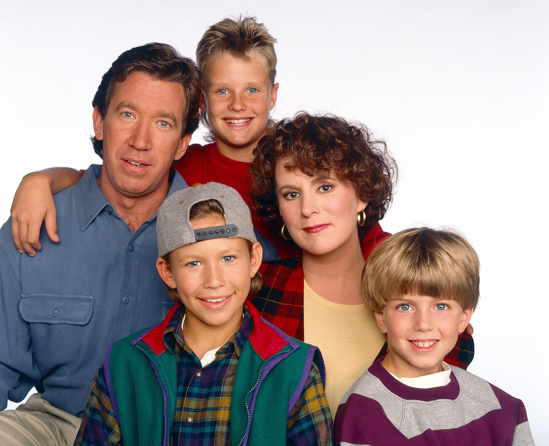 "Tim Allen, Jonathan Taylor Thomas, Zachery Ty Bryan, Patricia Richardson, and Taran Noah Smith pose for a ""Home Improvement"" promo shot, taken in 1992"