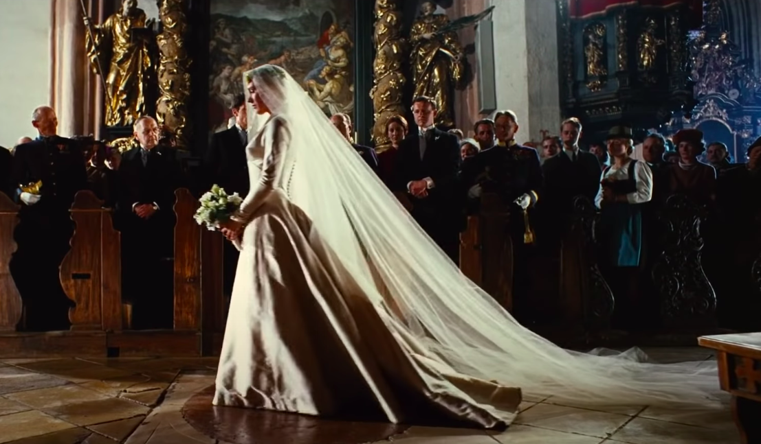 Maria wearing a long-sleeve ballgown with a long veil