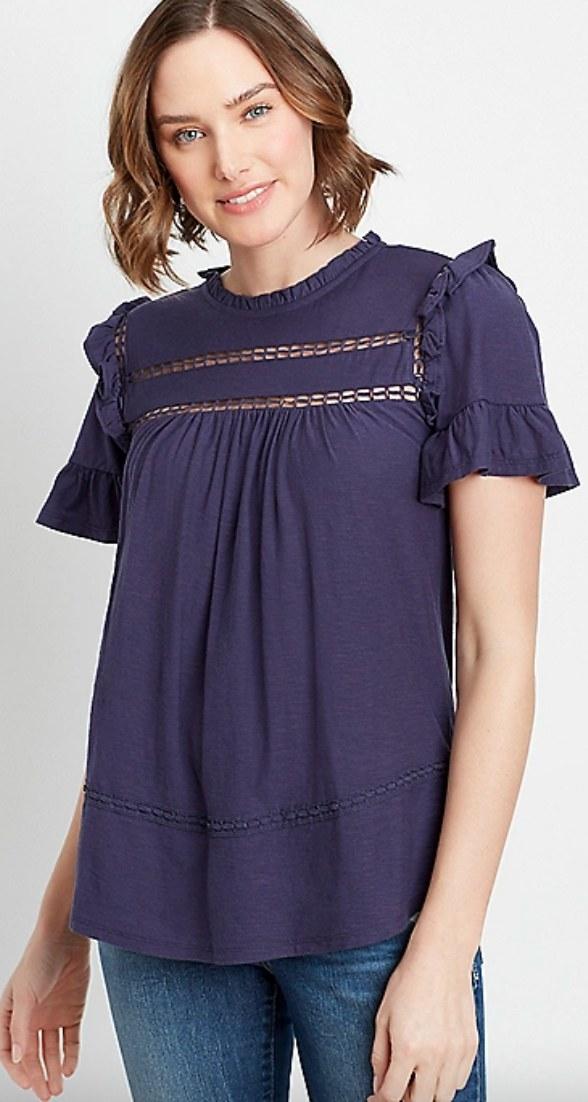 Thenavy crochet ruffle sleeve top on a model