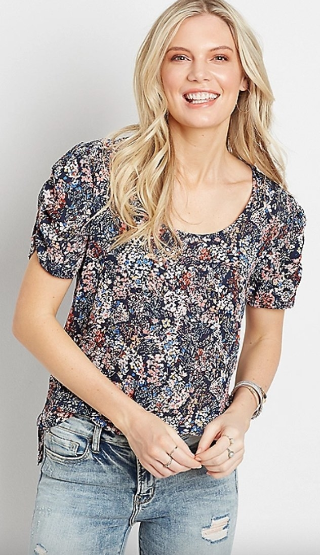 The blue floral ruched sleeve blouse on a model