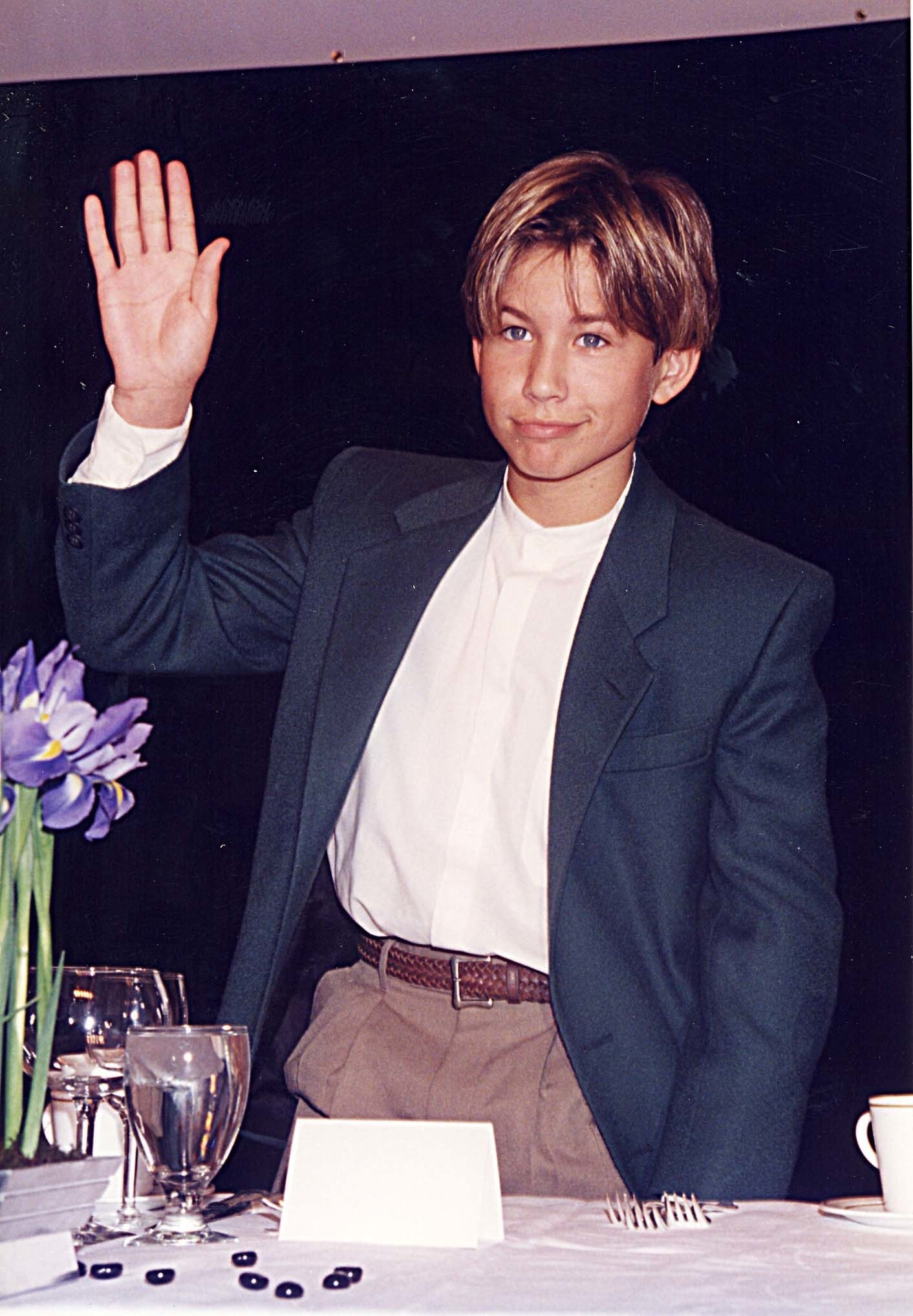 Jonathan Taylor Thomas waves during ShoWest '96 in Las Vegas, Nevada, United States