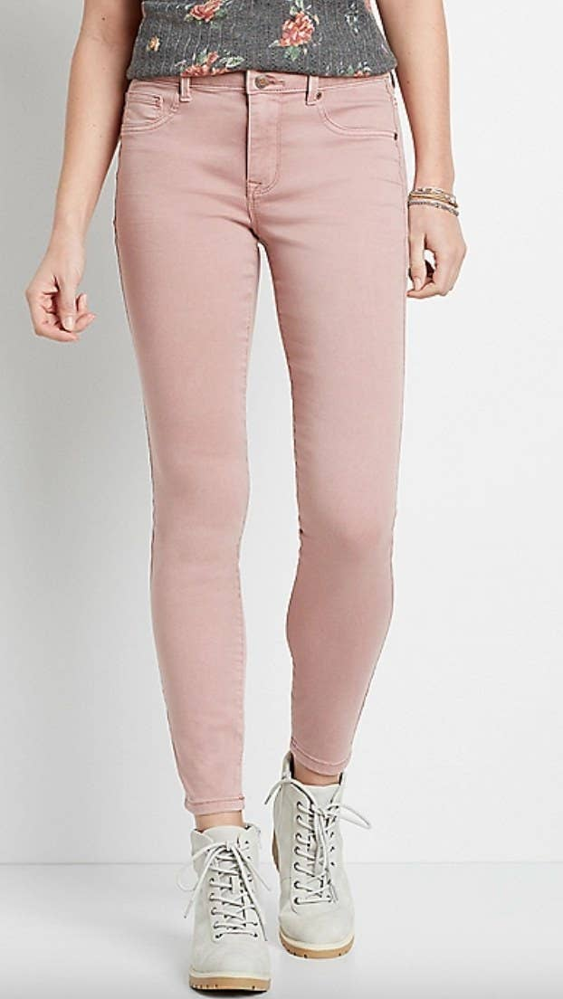 thepair of pink high rise jeanson a model