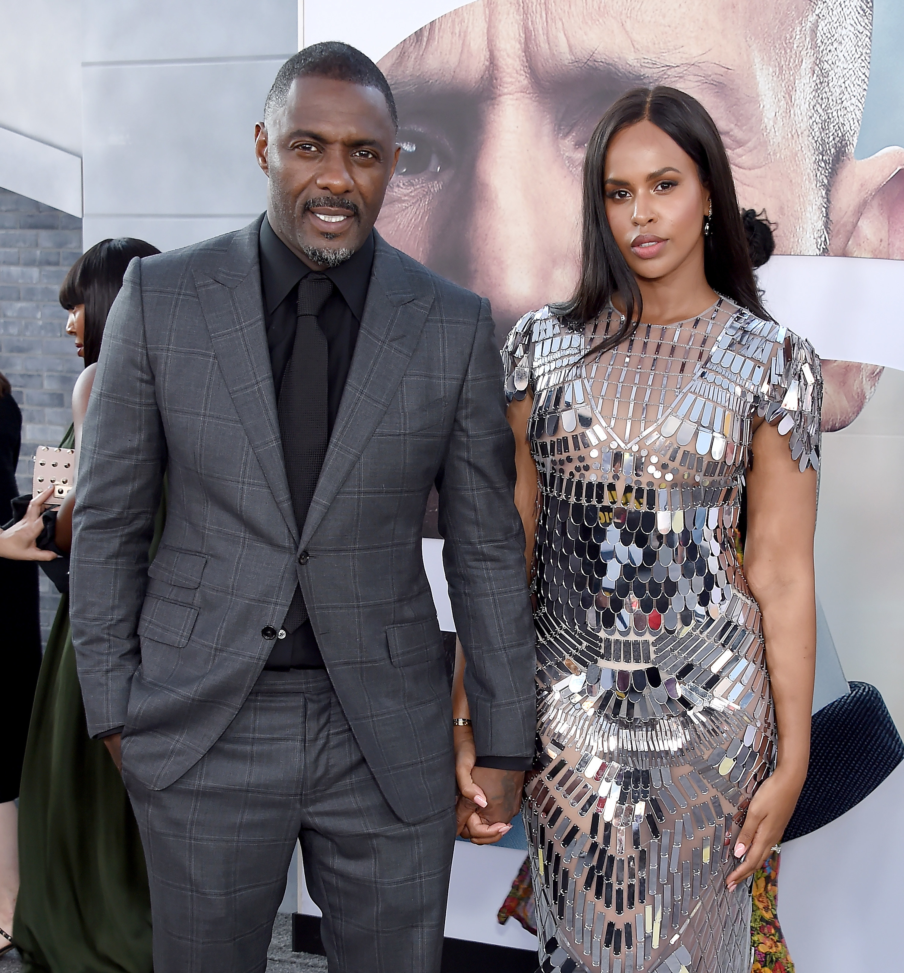 """Idris Elba and Sabrina Dhowre Elba hold hands at the premiere of """"Fast & Furious Presents: Hobbs & Shaw"""" in Hollywood"""
