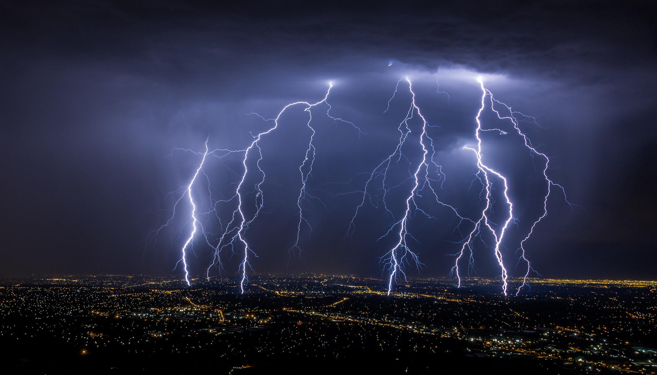 Lightning strikes a city at night