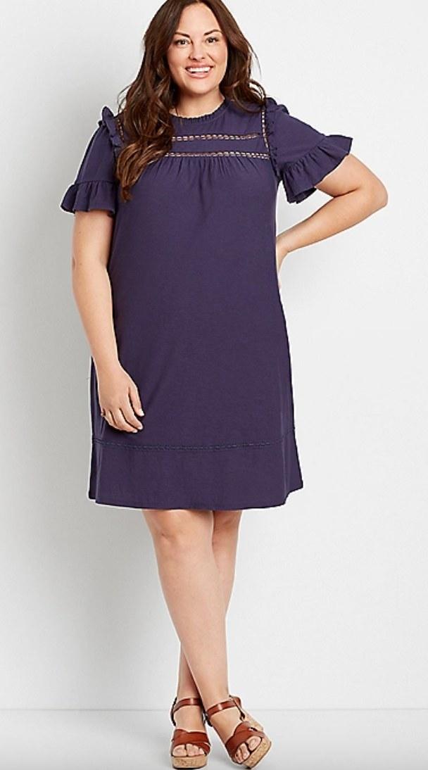 the navy crochet ruffle sleeve mini dress on a model