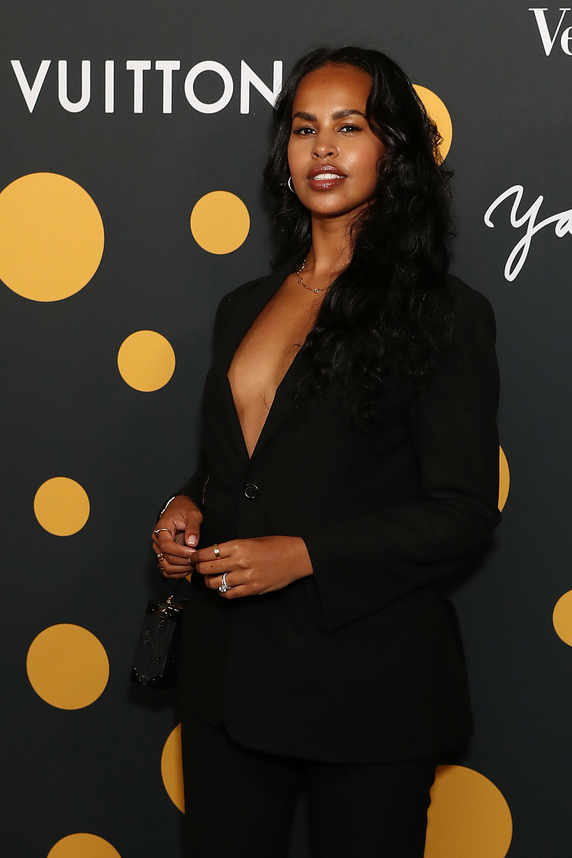 """Sabrina Elba arrives at a cocktail event to celebrate Veuve Clicquot's partnership with artist Yayoi Kusama and new vintage """"La Grande Dame 2012"""" at Louis Vuitton in Sydney,"""