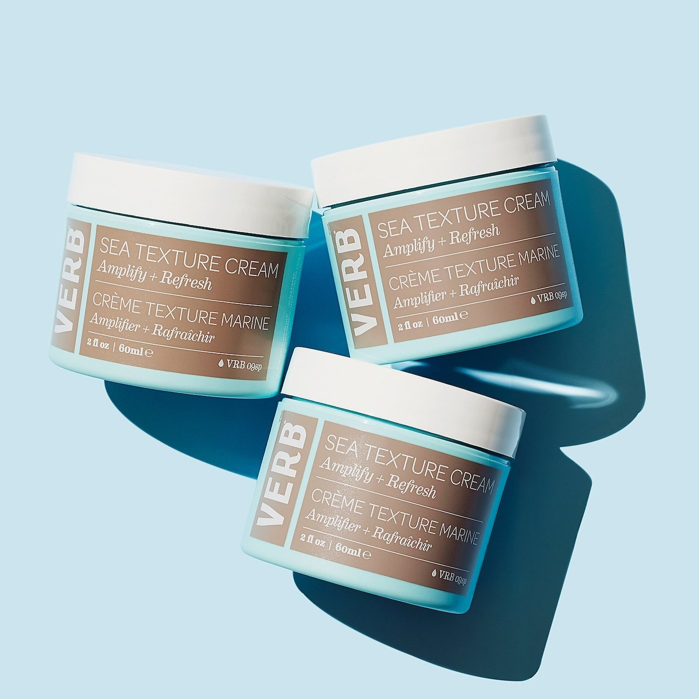 A blue and brown tub of texture cream
