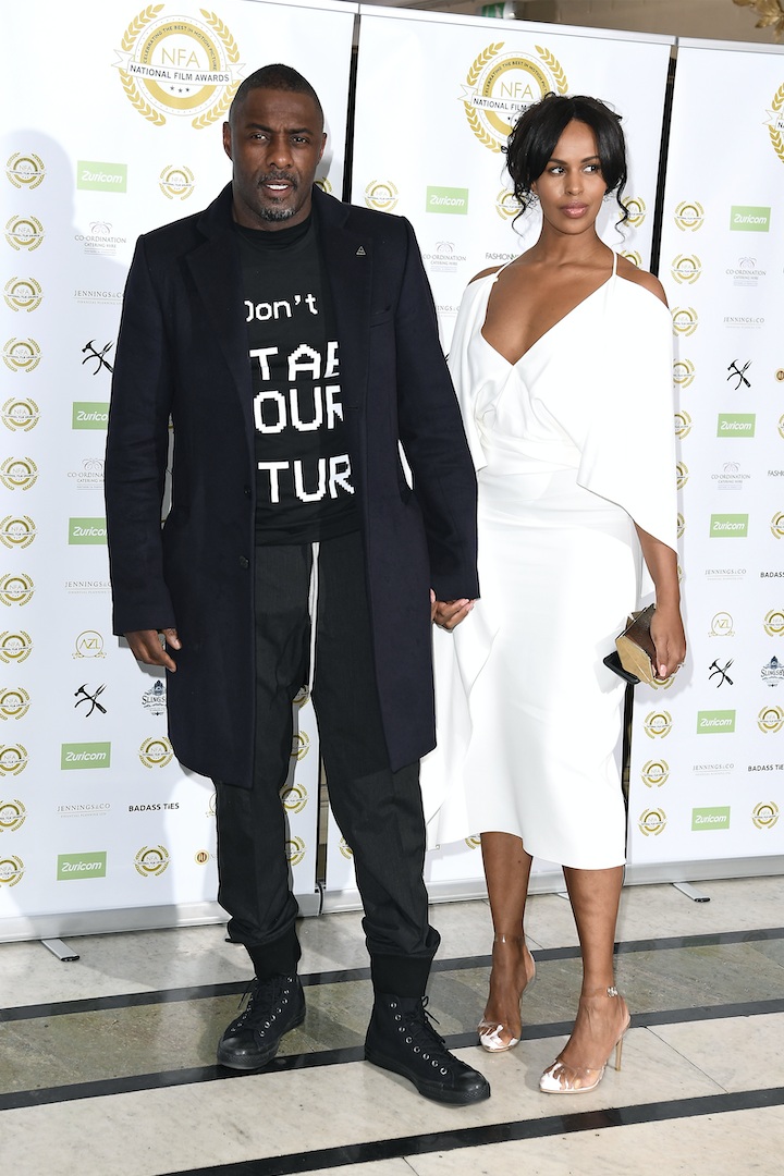 Idris Elba and Sabrina Dhowre hold hands the National Film Awards at Porchester Hall in London