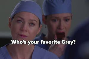 Meredith Grey stands with an annoyed look on her face as Lexie eats a candy bar in the background.