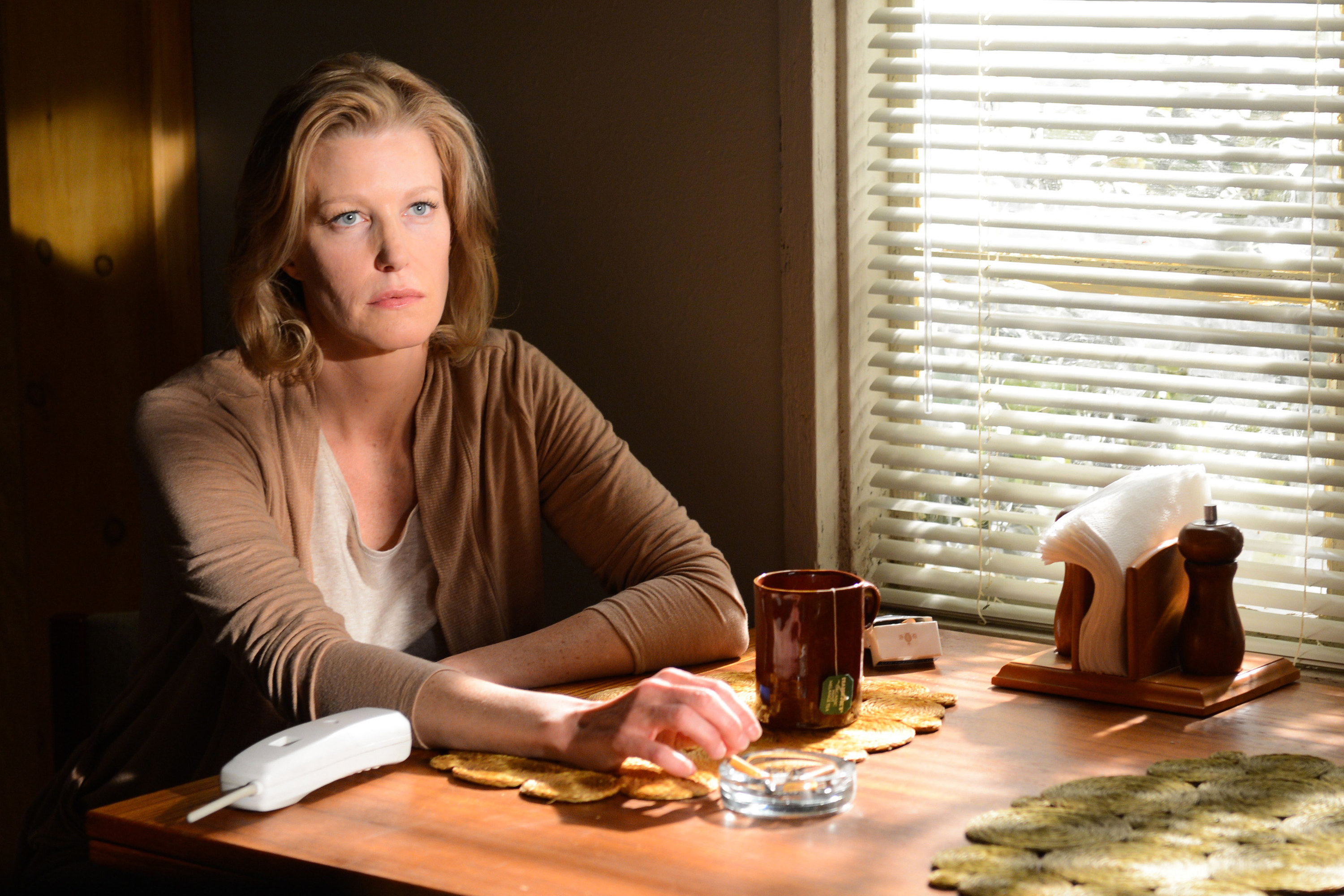 In the season finale, Skyler smokes at her kitchen table
