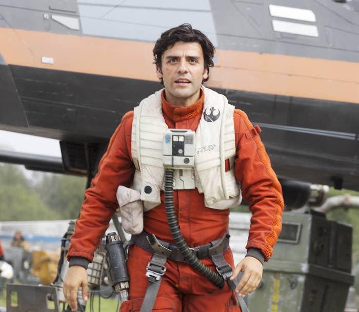 Poe in flight gear in the Force Awakens
