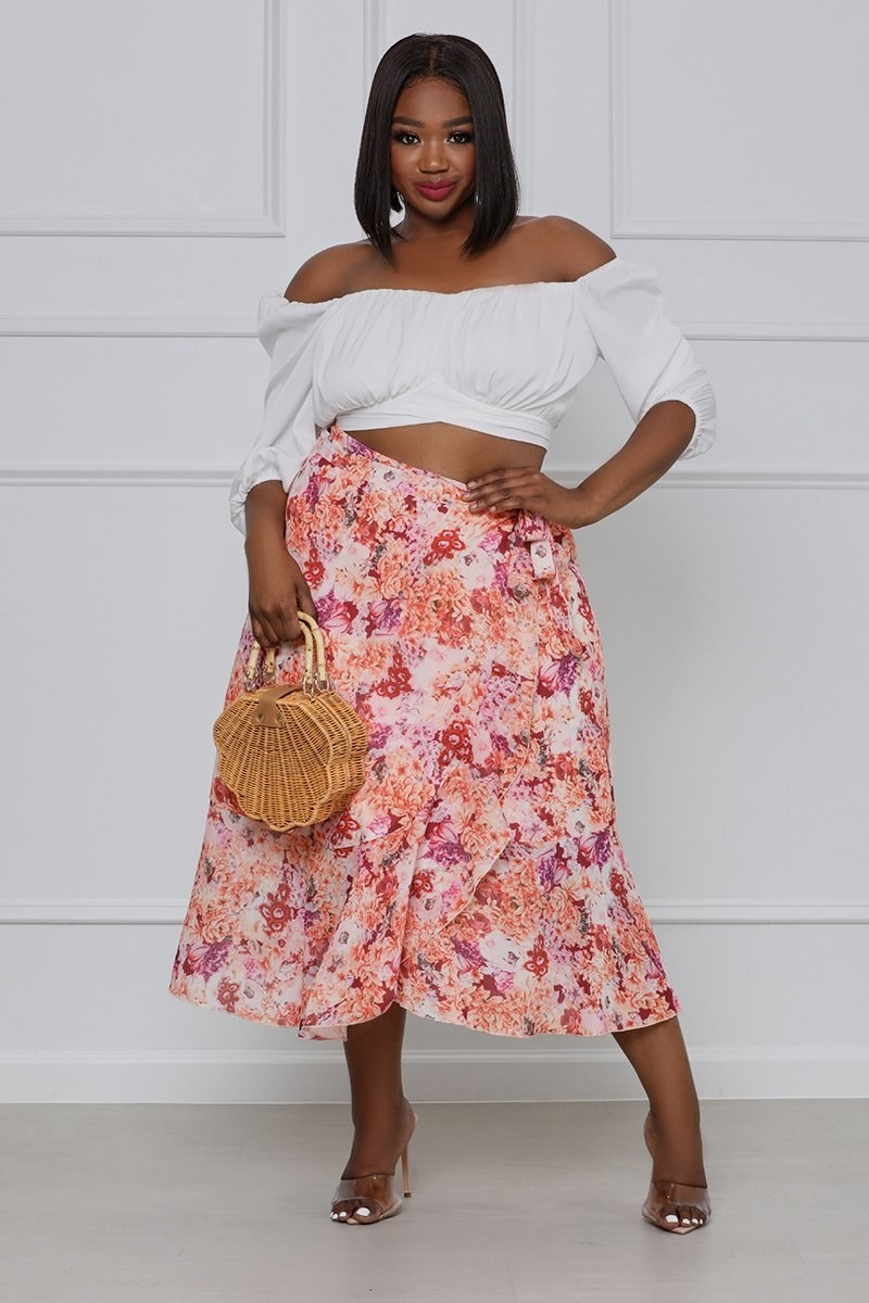 model wearing the floral pink and orange wrap skirt