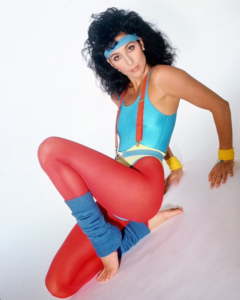 Cher poses for a portrait in athletic clothing in 1984