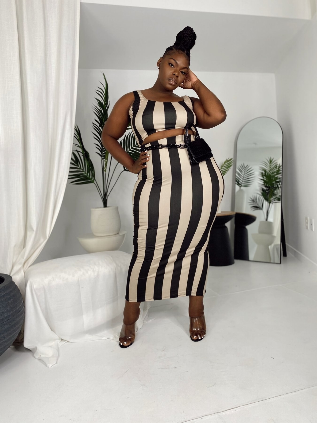 model wearing cropped tank and skirt set in black and tan vertical stripes