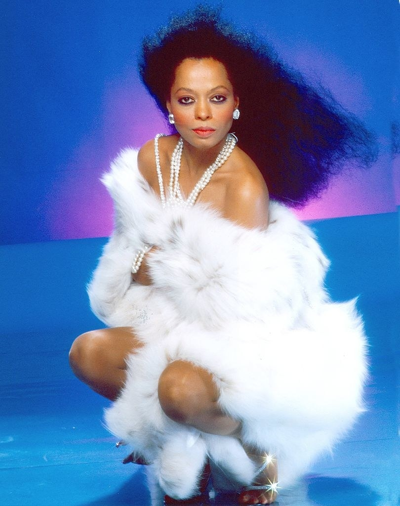 Diana Ross poses for a portrait in 1987 in a fur dress and pearls