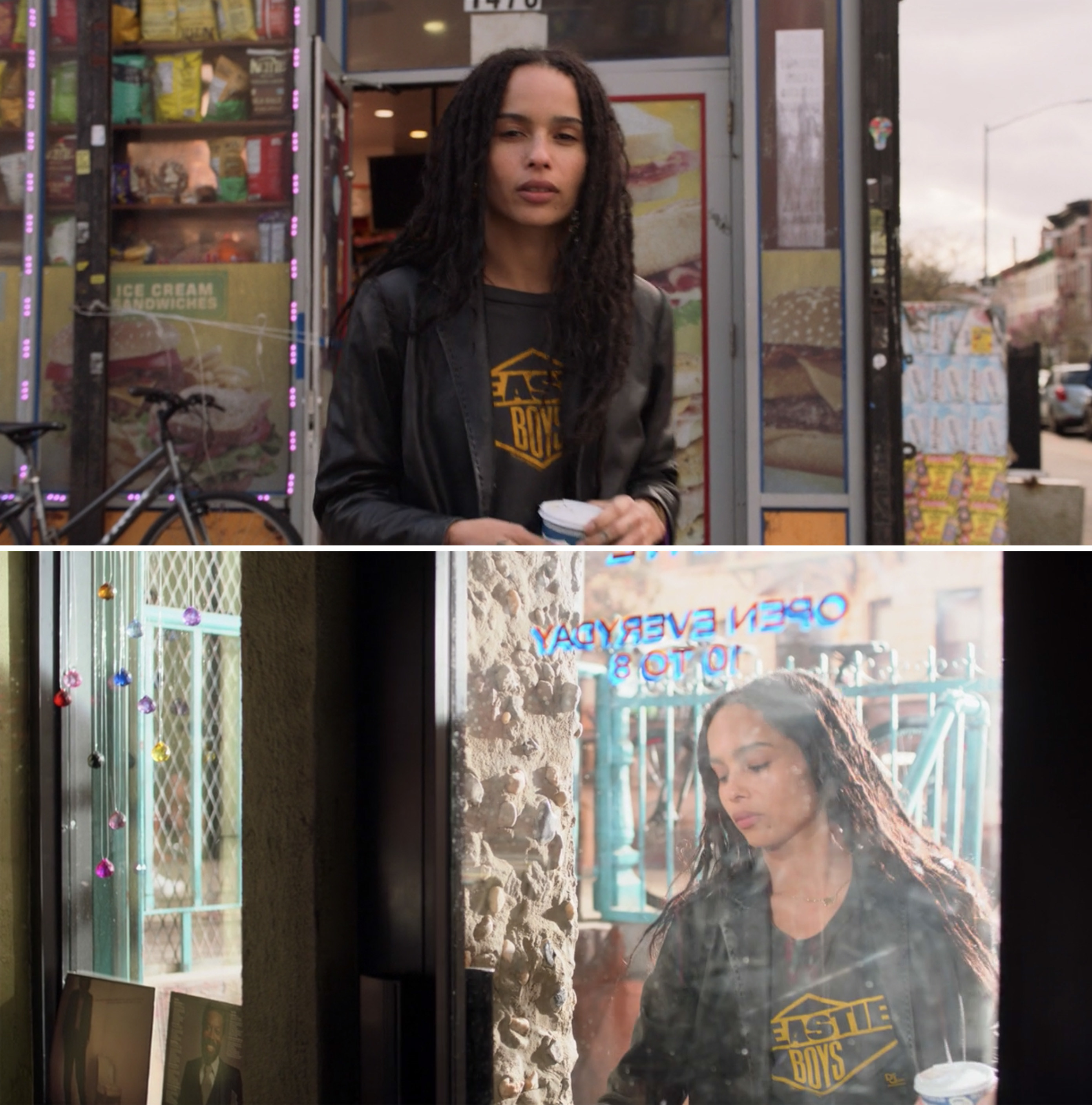 Rob standing on the street and entering her record store