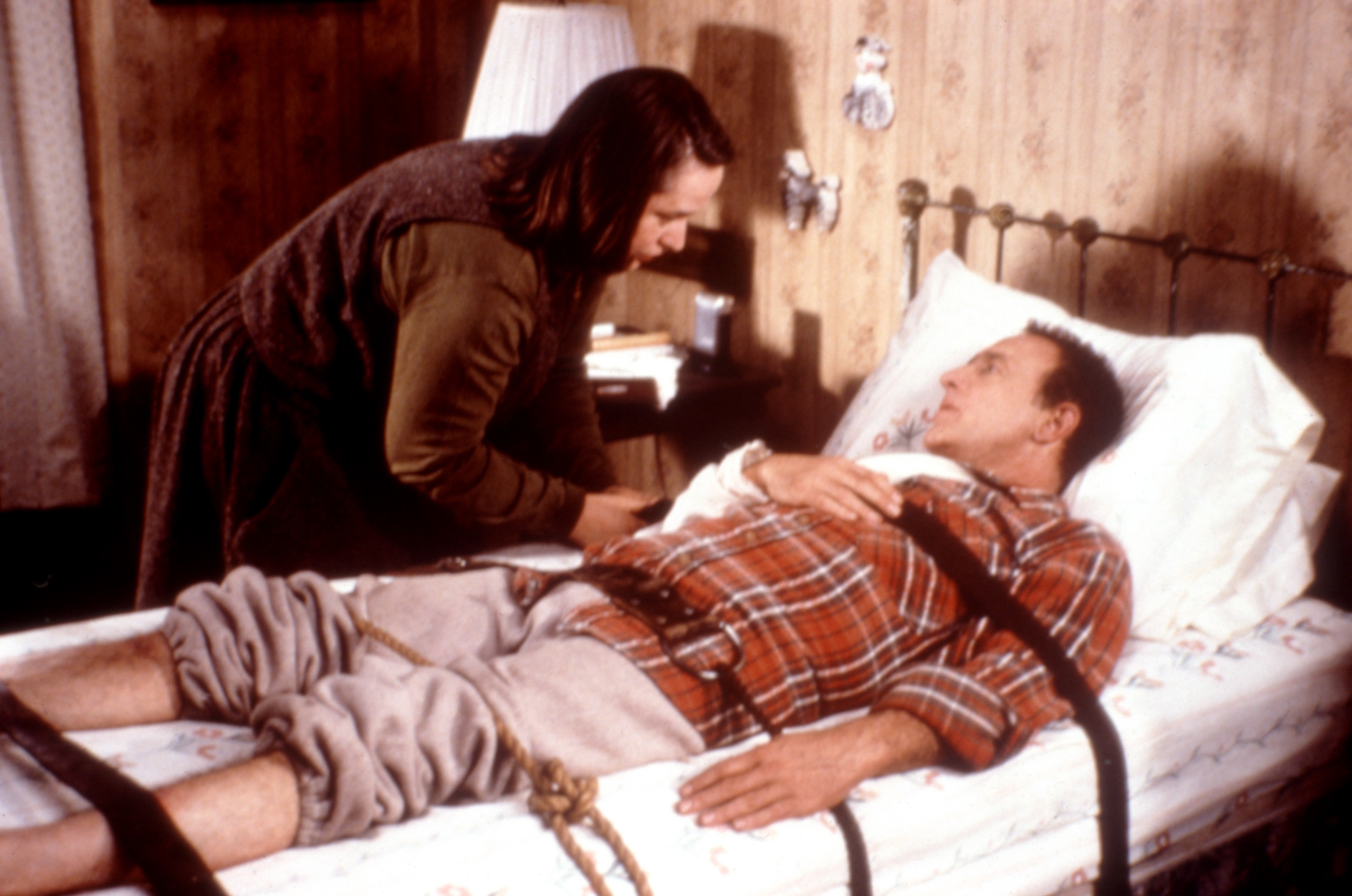 Paul Sheldon tied to a bed by Annie Wilkes