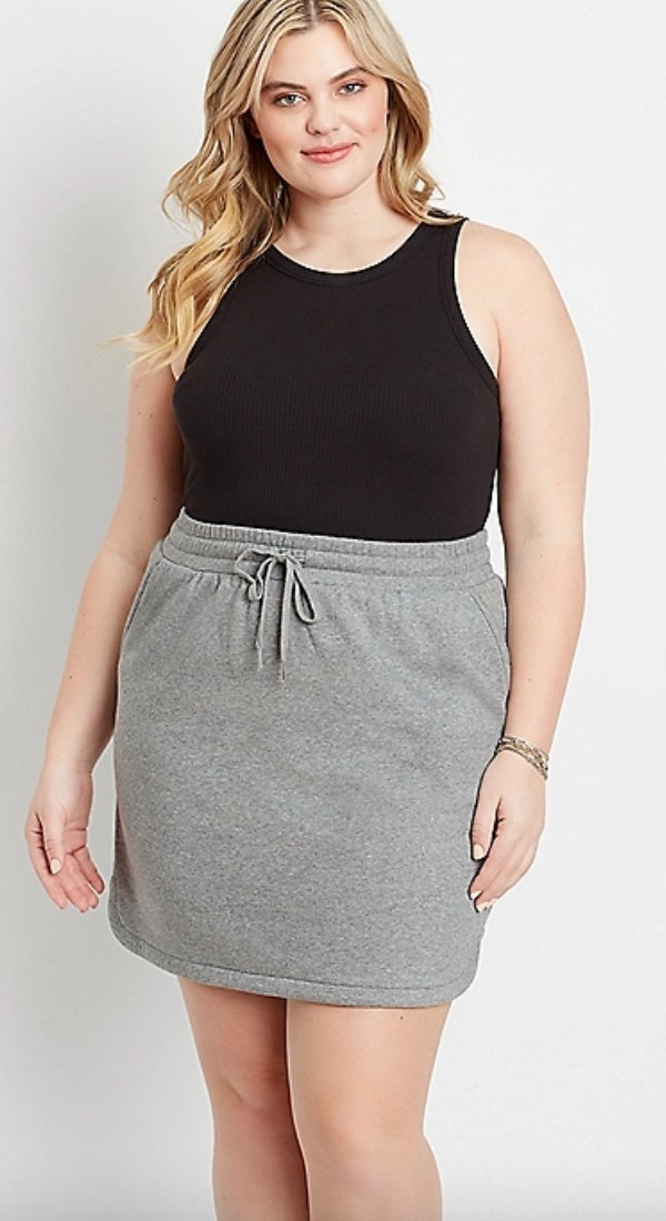 the plus size terry skirt in gray on a model
