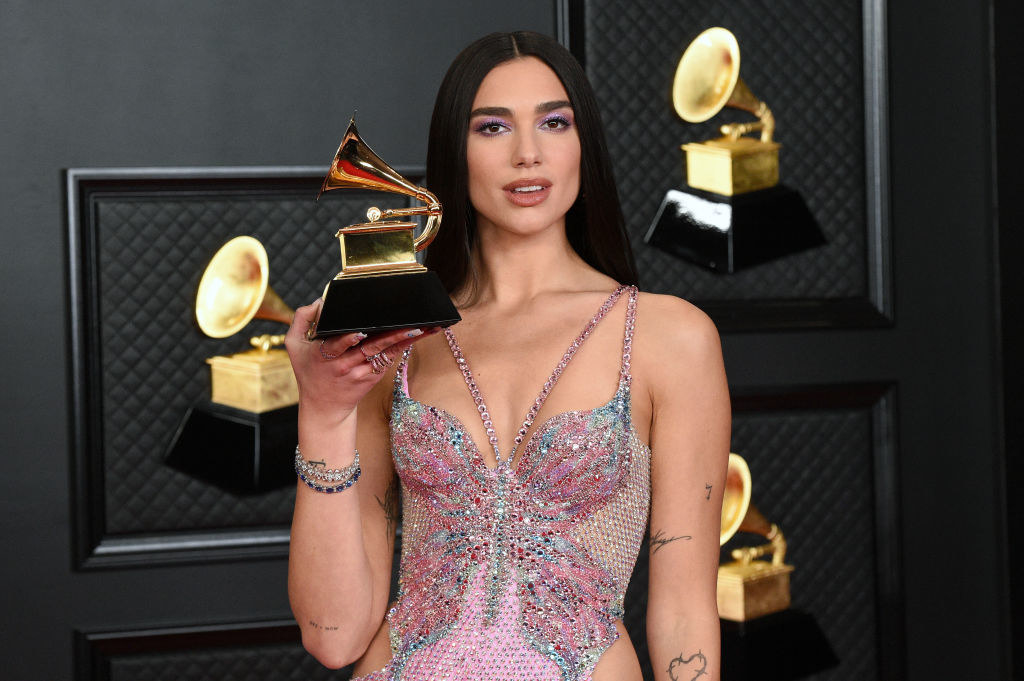 Dua Lipa at the Grammy Awards holding her trophy