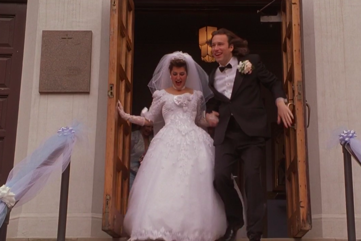 Toula wearing an embroidered ballgown with a large veil