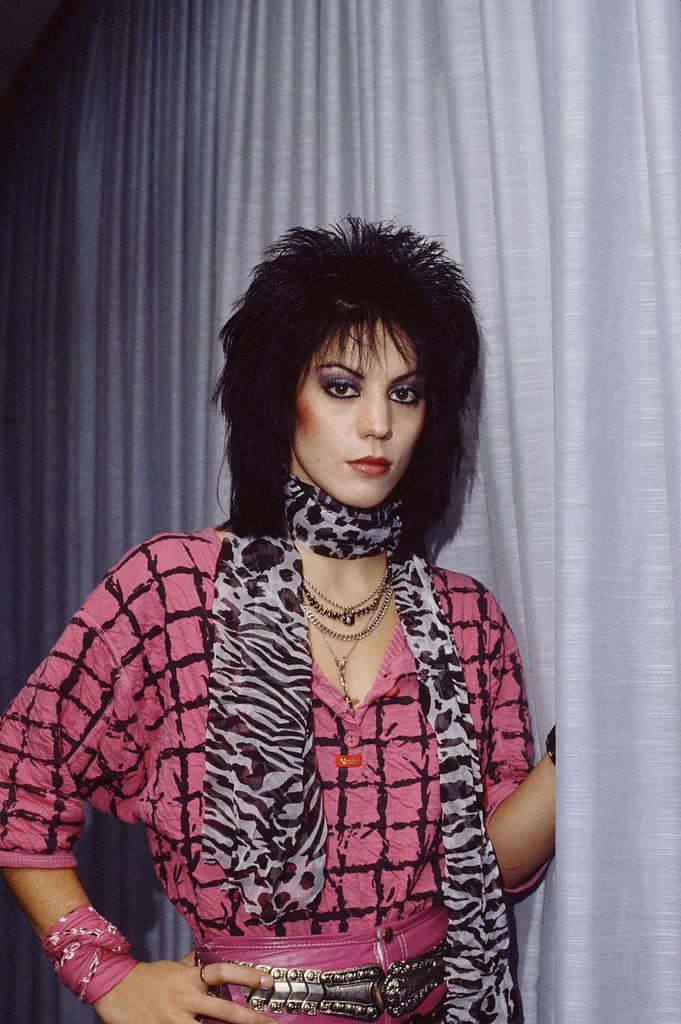 Joan Jett posing for a portrait backstage in 1984