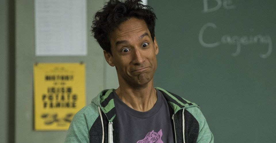 Abed makes a weird face. His hair is mussed and he is wearing a t shirt and zippered hoodie