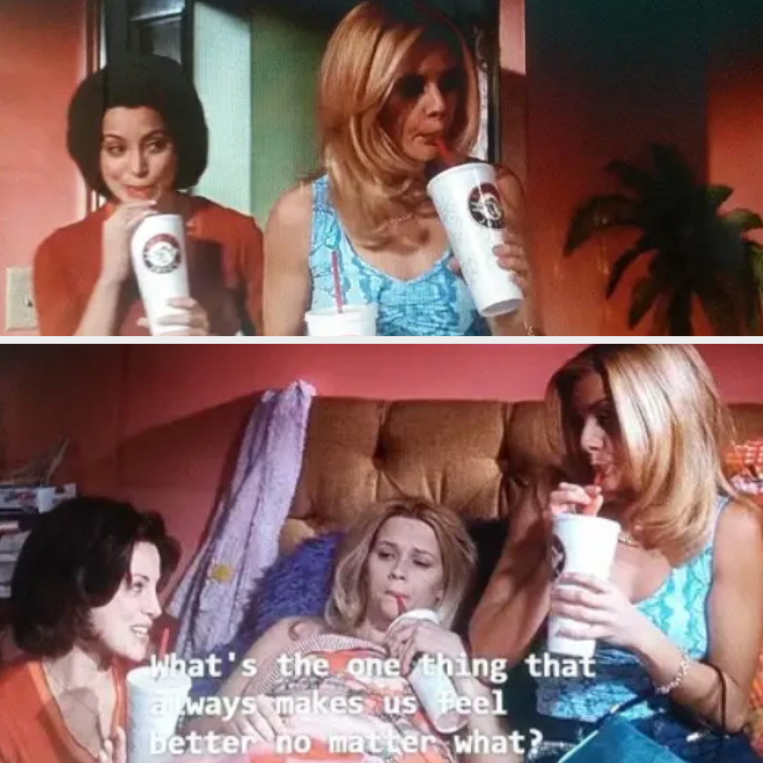 Elle is lying down in her bed drinking the smoothie Margot gave her. On one side of her is Margot and the other side is Serena. They are also drinking smoothies.