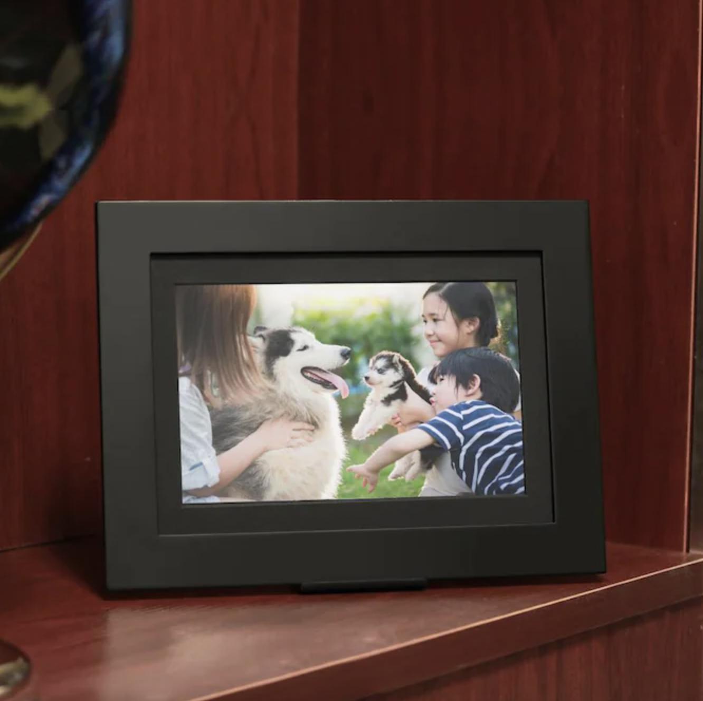 Digital picture frame sitting on shelf