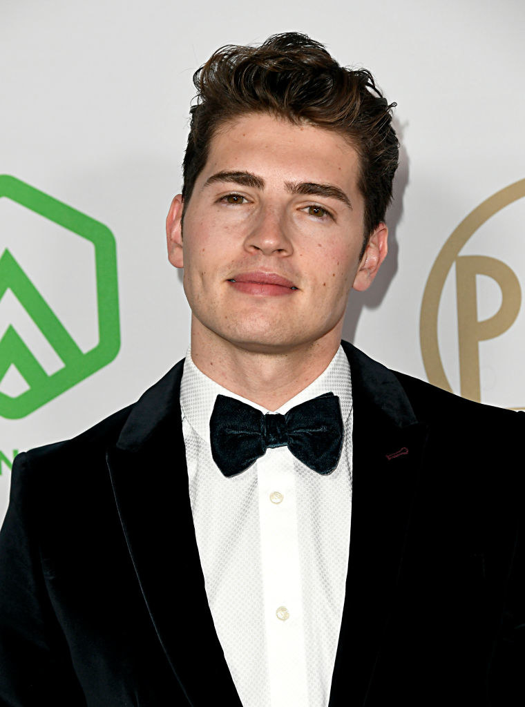 Gregg Sulking in a suit and bowtie at a red carpet