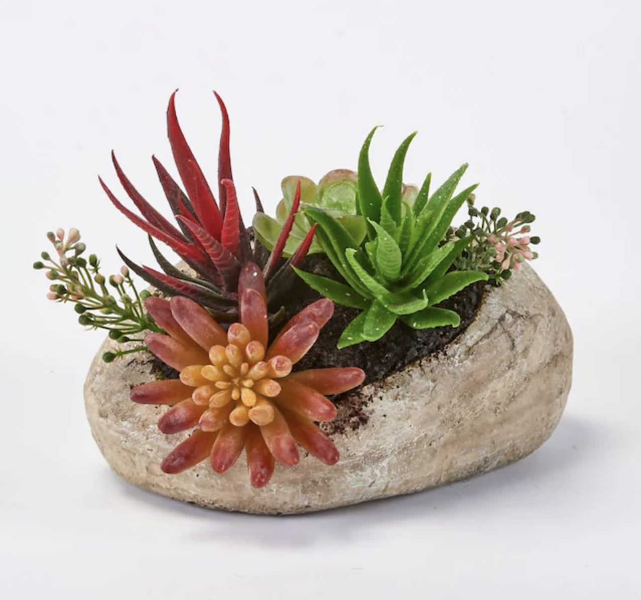 Closeup of faux succulents in rock-shaped planter