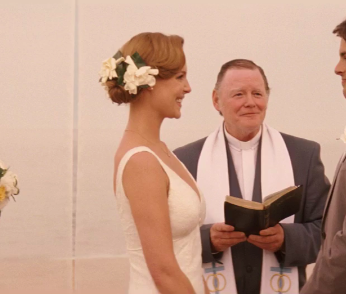 Jane wearing a wedding dress with thick straps