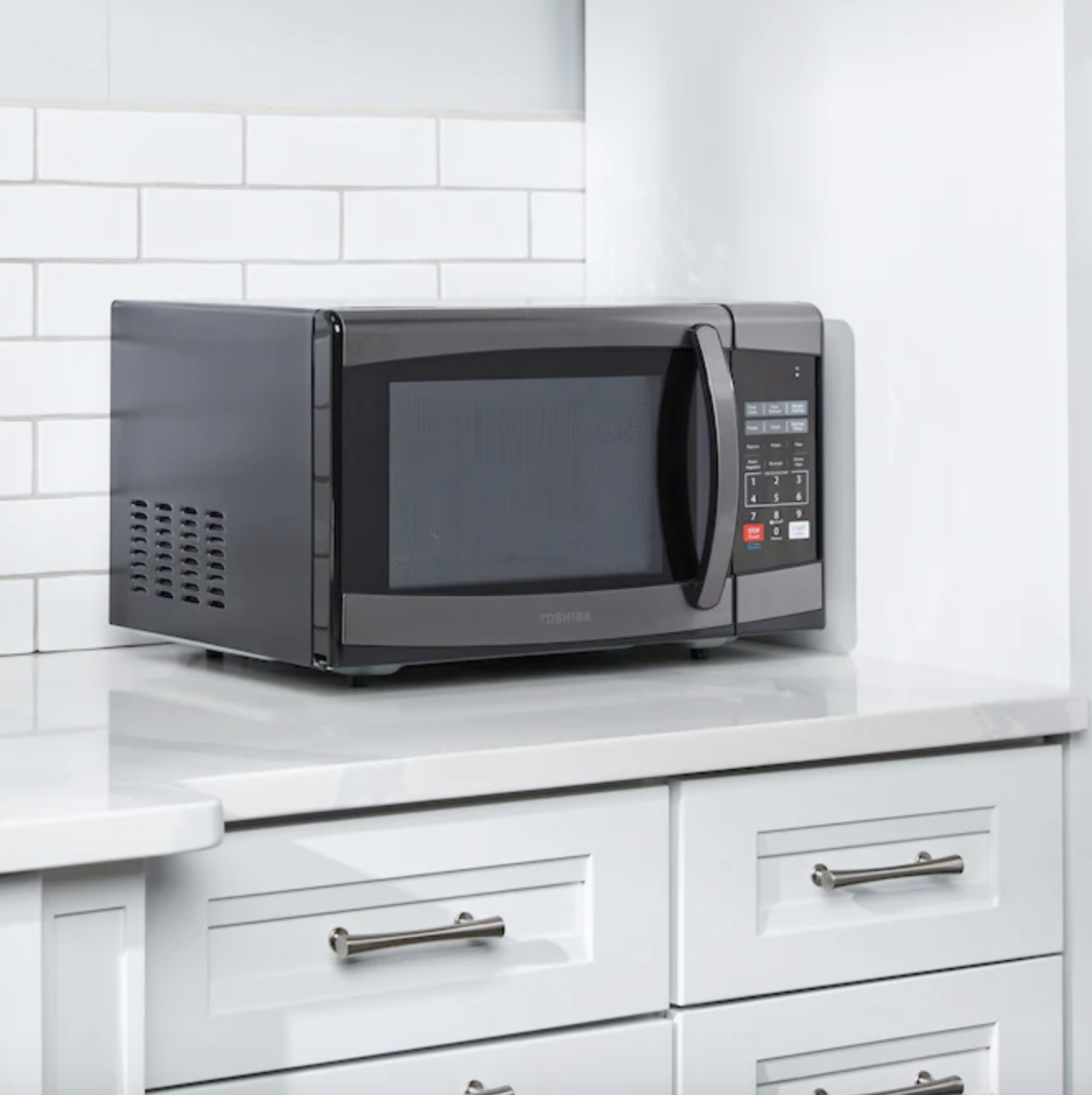 Microwave sitting on kitchen counter