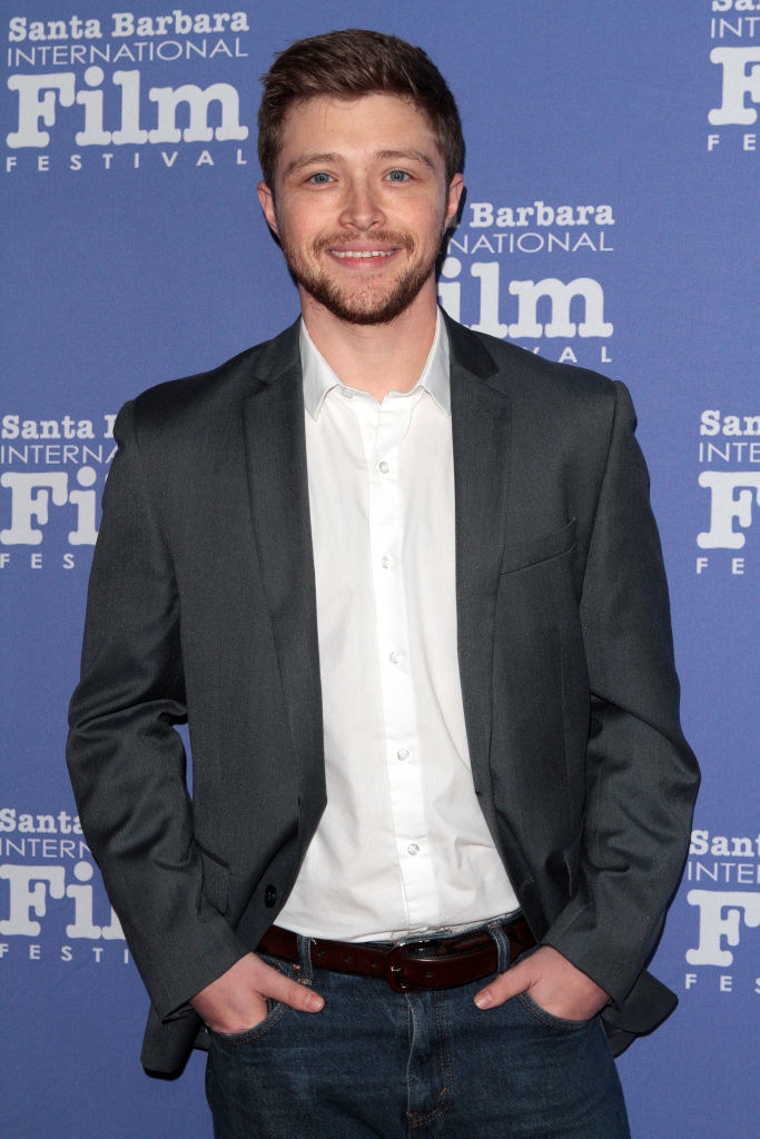 Sterling Knight wearing a sport jacket and jeans at a red carpet