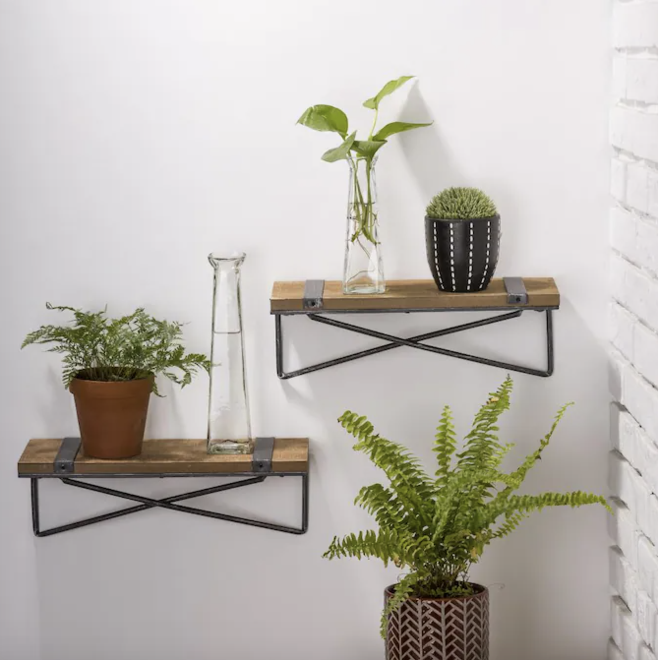 Two wood shelf boards hanging on wall
