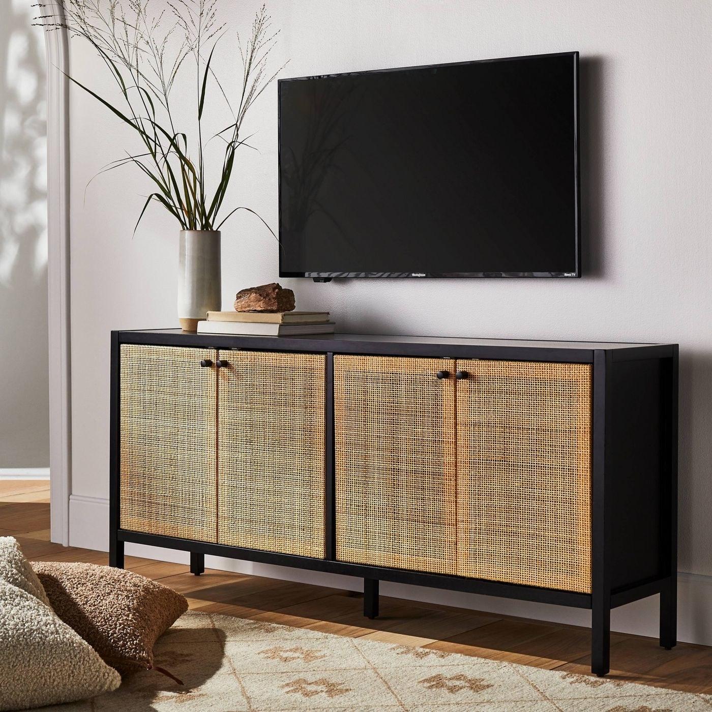 a black and cane cadenza under a TV