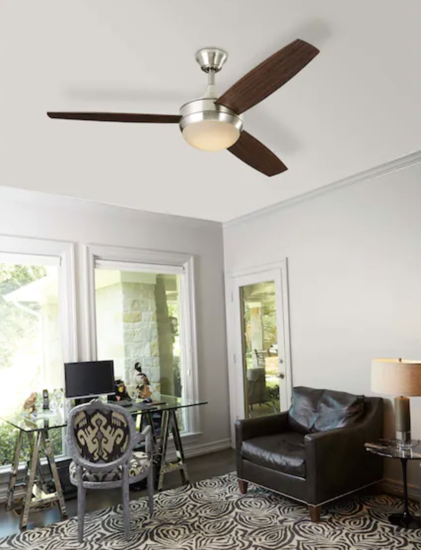 Ceiling fan installed in room